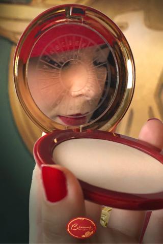Woman Wearing Bésame's Red Velvet Lipstick