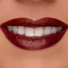 Smiling lips wearing red lipstick