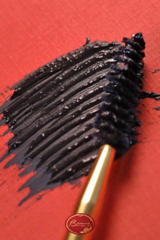 Black-cake-mascara-swatch-on-red-background